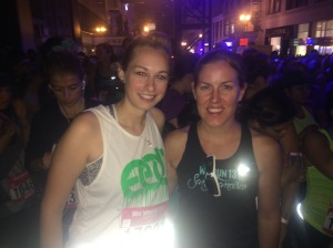 Finding a familiar face in the crowd at the Nike Women's 2014 Half Marathon.