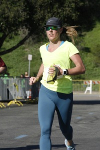 Less than a mile from the finish at the 2015 Rose Bowl Half Marathon. Happy lady, running at ease.